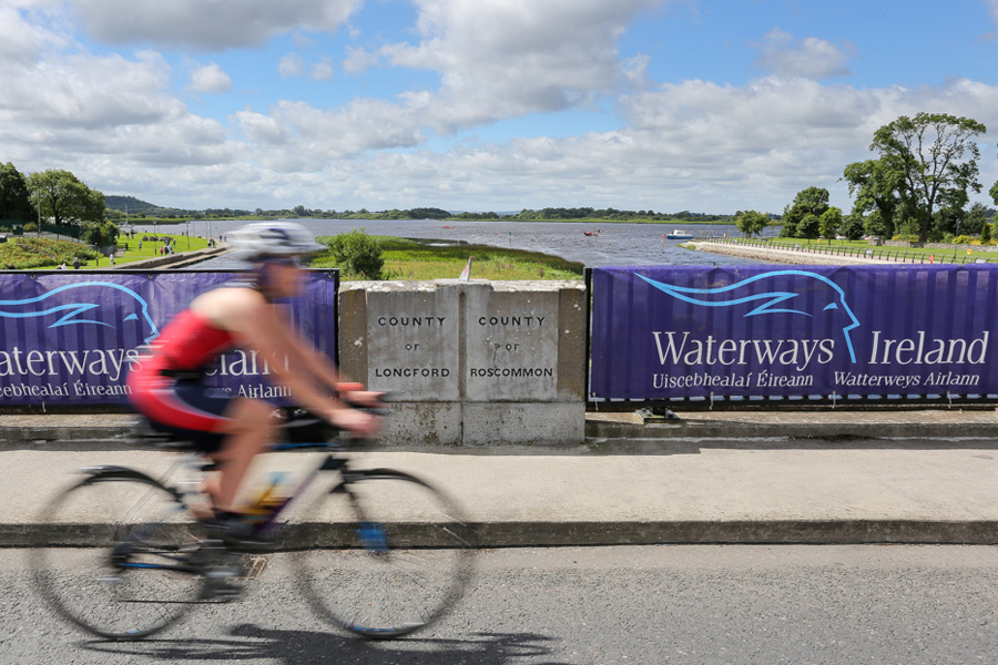 Two Provinces Triathlon 2016 - Cyclist crossing from Longford into Roscommon on the bridge in Lanesborough